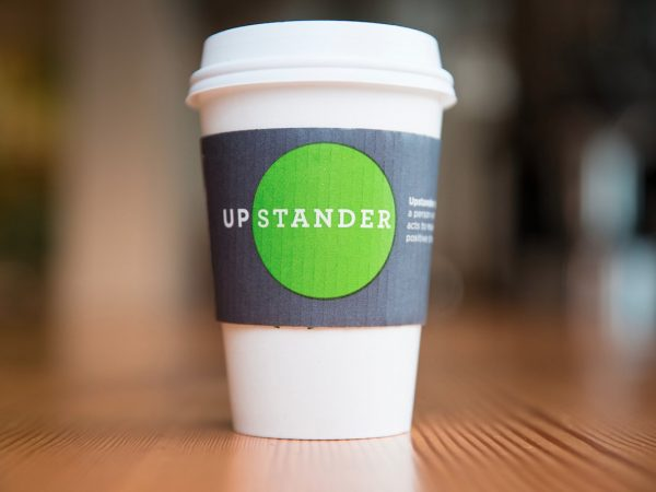 Upstanders branded cup promoting their video marketing